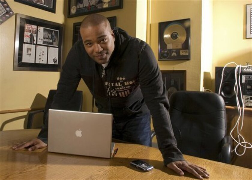 FILE - This Feb. 28, 2007 file photo shows hip-hop mogul Chris Lighty in his office in New York. Lightly died of an apparent gunshot wound on Thursday, Aug. 30, 2012 at his home in the Bronx borough of New York. He was 44. Lighty was the man behind rapís leading figures, helping them not only attai