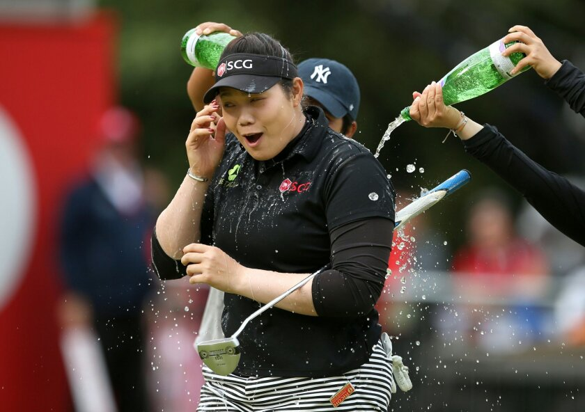 Thailand's Ariya Jutanugarn celebrates after sinking her putt to win the Women's British Open during day four of the Women's British Open at Woburn Golf Club, Woburn, England, Sunday July 31, 2016. Jutanugarn took the Women's British Open title at the tree-lined Woburn course. (Steve Paston / PA vi