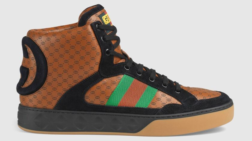 Luxury brand Gucci is working with New York stylist and '80s counterfeiter-turned-fashion collaborator Dapper Dan. Their collection includes high-top sneakers that could easily be seen on your local basketball court.