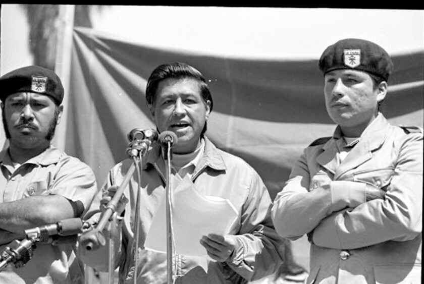Cesar Chavez flanked by two Brown Berets