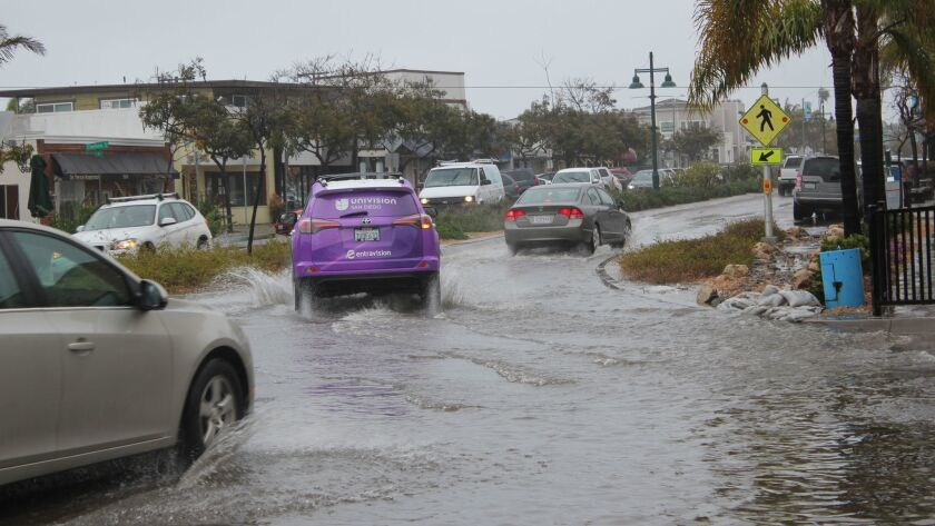 The north side of La Jolla Boulevard at Forward Street flooded during the Feb. 27 rain event, inundating the road. However, cars were able to drive through with caution.