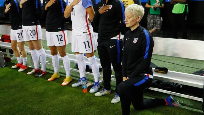 Megan Rapinoe kneels during the national anthem before a game against the Netherlands on Sept. 18, 2016, in Atlanta, Georgia.