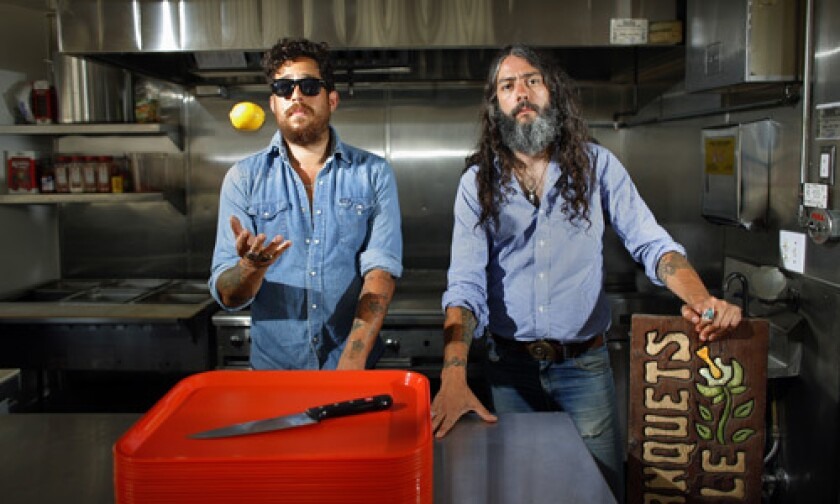 Curtis Brown, left, and Tony Presedo in the kitchen of Territory Barbecue & Records, slated to open in mid-May in Silver Lake.