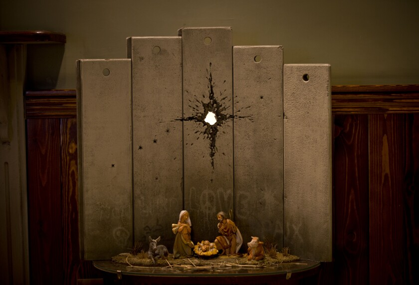 "The new Banksy artwork ""Scar of Bethlehem"" has been installed at the Walled Off Hotel in Bethlehem."