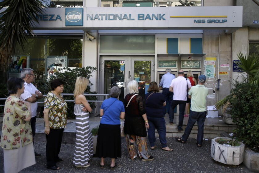 """People line up at an ATM in Athens next to a closed bank. In London, a crowdfunding campaign called the """"Greek Bailout Fund"""" has been launched on Indiegogo."""