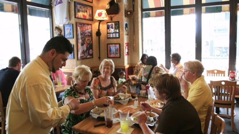 Customers chat over lunch at an Applebee's in New York.