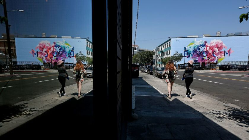 """""""Bloom,"""" reflecting on a window in the Arts District."""