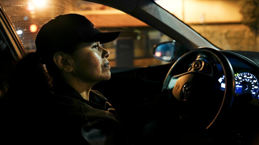 Silvia Vigil drives down International Boulevard in Oakland, looking for women she thinks are prostitutes.