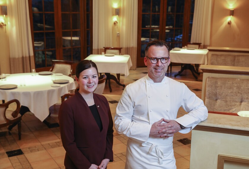 New wine director Victoria O'Bryan, left, and founding executive chef William Bradley pose for photos in the newly remodeled dining area at Addison, San Diego County's only Michelin-starred restaurant, in Carmel Valley.