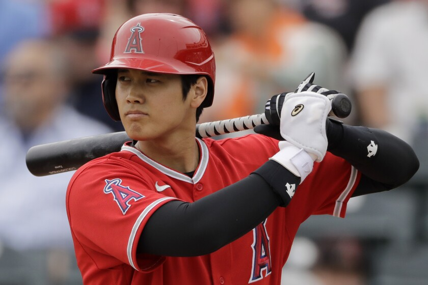 The Angels' Shohei Ohtani bats during spring training against the Rangers on Feb. 28, 2020, in Tempe, Ariz.