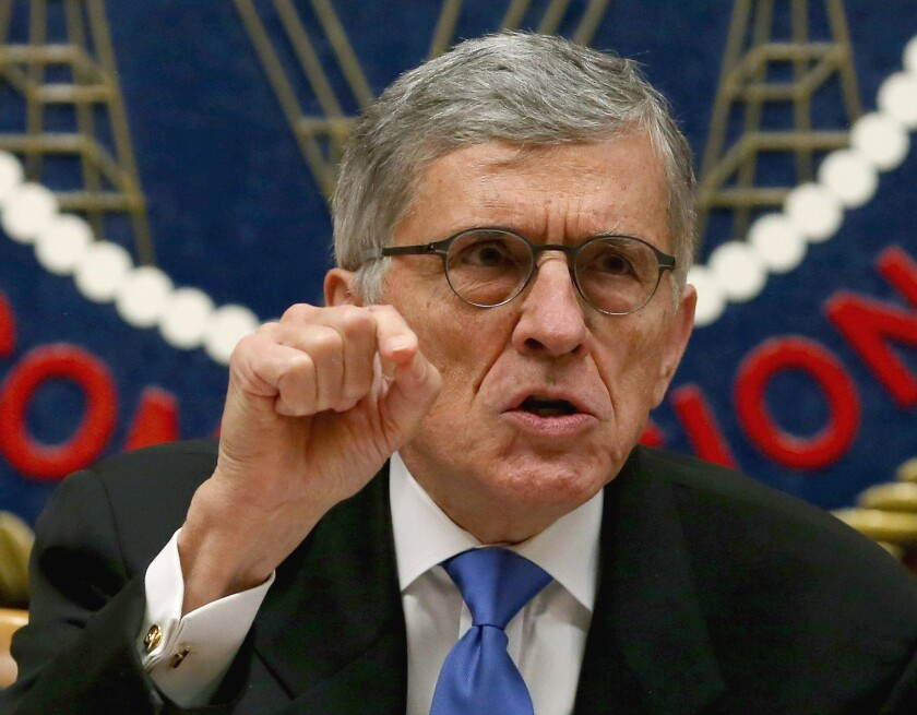 Federal Communications Commission Chairman Tom Wheeler speaks before voting on net neutrality regulations on Feb. 26. The rules were published in the Federal Register on Monday and a telecommunications industry trade group filed suit to stop them.