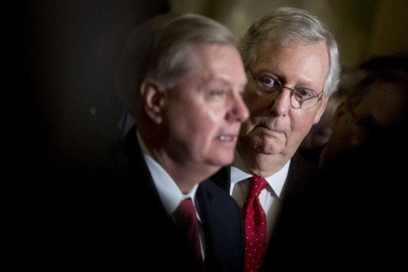 Sen. Lindsey Graham, R-S.C., flanked by Senate Majority Leader Mitch McConnell, R-Ky.