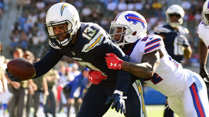 Keenan Allen of the Chargers stretches for a touchdown while being defended by Leonard Johnson of the Buffalo Bills during the second quarter.