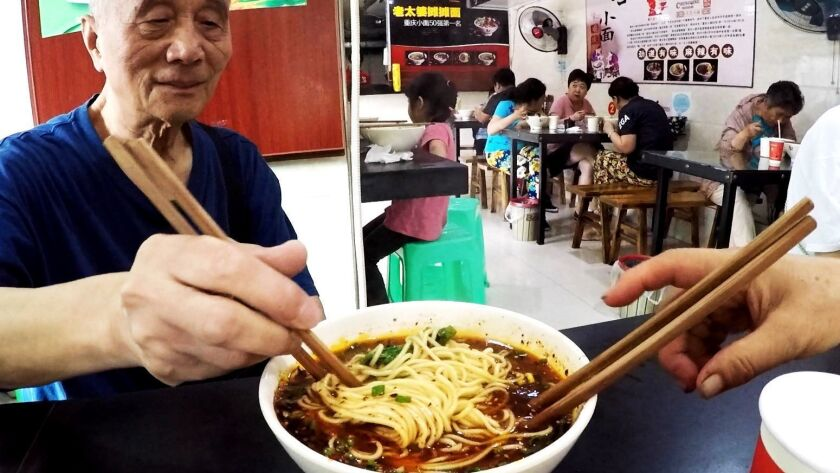 Xiao mian, an iconic Chongqing noodle dish, can be found on any street corner for $1 US.