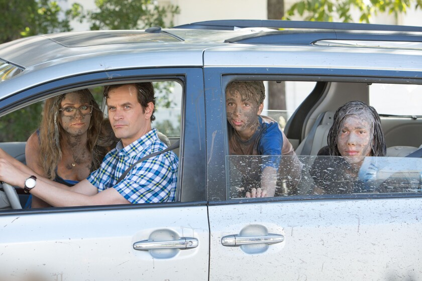 """( L-r) Alicia Silverstone, Tom Everett Scott, Jason Drucker and Charlie Wright in """"Diary of a Wimpy Kid: The Long Haul."""""""