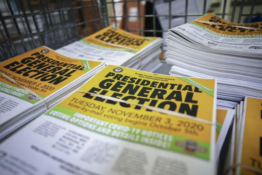 Voter information guides sit bundled at the Orange County Registrar of Voters on October 19, 2020 in Santa Ana, California.