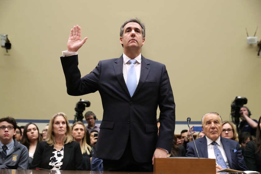Michael Cohen, former attorney and fixer for President Donald Trump, testifies before the House Oversight Committee in Washington on Feb. 27, 2019.