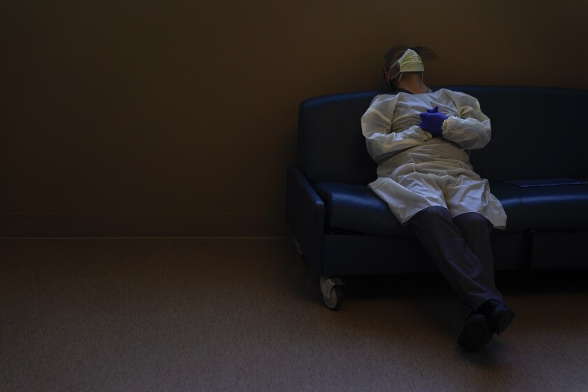 Dr. Mher Onanyan takes a short break while waiting for an X-ray of a COVID-19 patient's lungs. (AP Photo/Jae C. Hong)