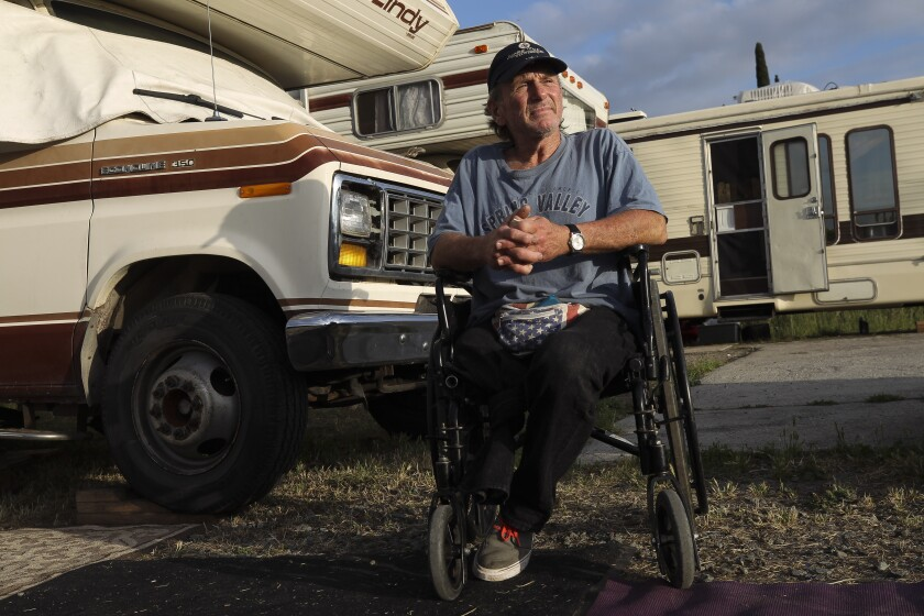 Jeff Tracy, 57, who uses a wheel chair due to losing his right leg in a traffic accident that also killed his wife and daughter, sits in front of his RV, which he lives in, at a safe lot operated by Dreams for Change on Thursday, May 23, 2019 in San Diego, California.