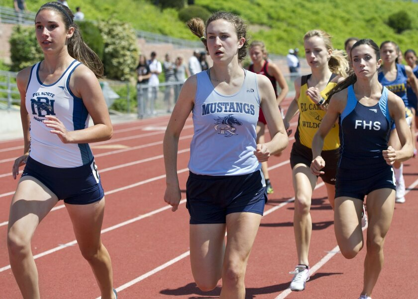 Carina Gillespie, center in light blue, of Otay Ranch High school, runs in the Girls 800 Meter Run during the 2013 Jaguar Invitational at Valley Center High School. Gillespie won the race.