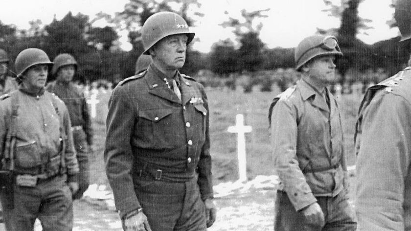 General George S. Patton attends the funeral of General Theodore Roosevelt, Jr. in Normandy on July