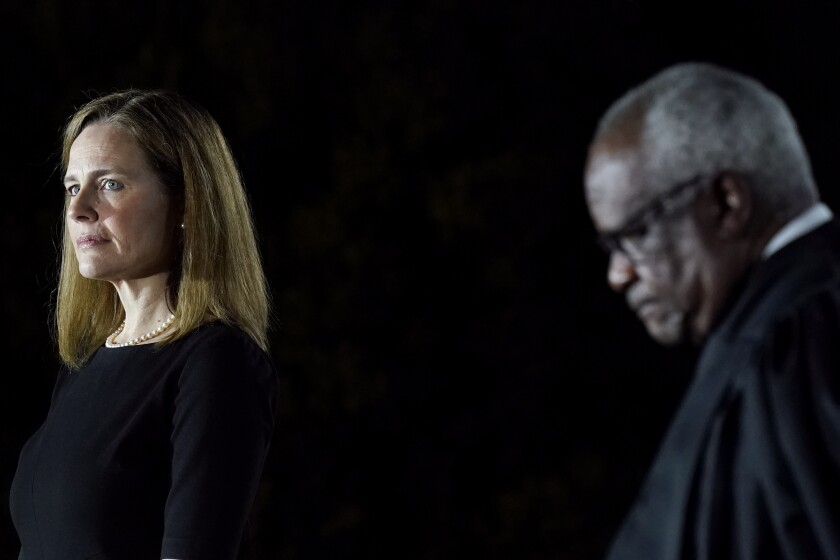 Justices Amy Coney Barrett and Clarence Thomas