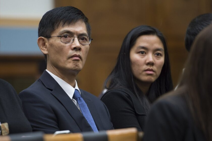 The Chairman of Temple University's Physics Department, Xi Xiaoxing, left, listens as U.S. Atty. Gen. Loretta Lynch responds to a question while testifying before the House Judiciary Committee. Earlier this year, Xiaoxing was arrested on espionage charges that were later dropped.
