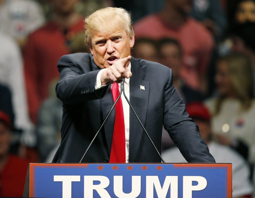 Republican presidential candidate Donald Trump gestures during a speech to a rally in Oklahoma City, Friday, Feb. 26, 2016. (AP Photo/Sue Ogrocki)