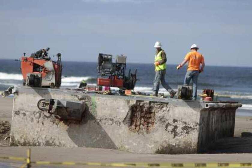 Tsunami debris: Oregon workers begin slicing up Japanese dock