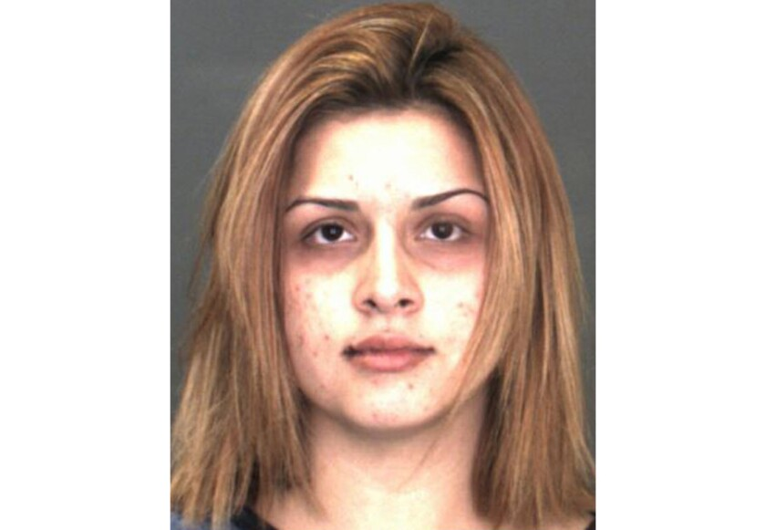Kimberly Torres, 20, of San Bernardino. Torres was arrested on suspicion of child endangerment after her daughter emerged from a bedroom with a loaded, stolen firearm, according to authorities.