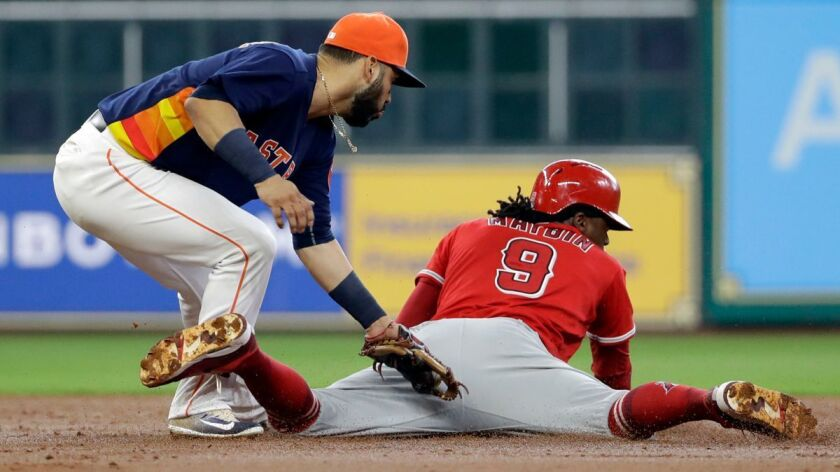 Los Angeles Angels' Cameron Maybin (9) steals second base safely as Houston Astros shortstop Marwin