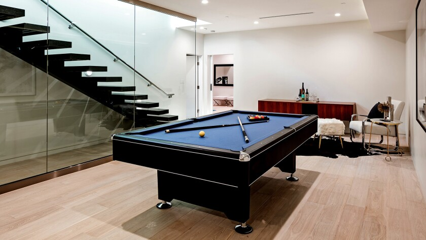 This newly built multilevel Home of the Week in Beverly Hills includes a game/billiard room, a home theater and a putting green.
