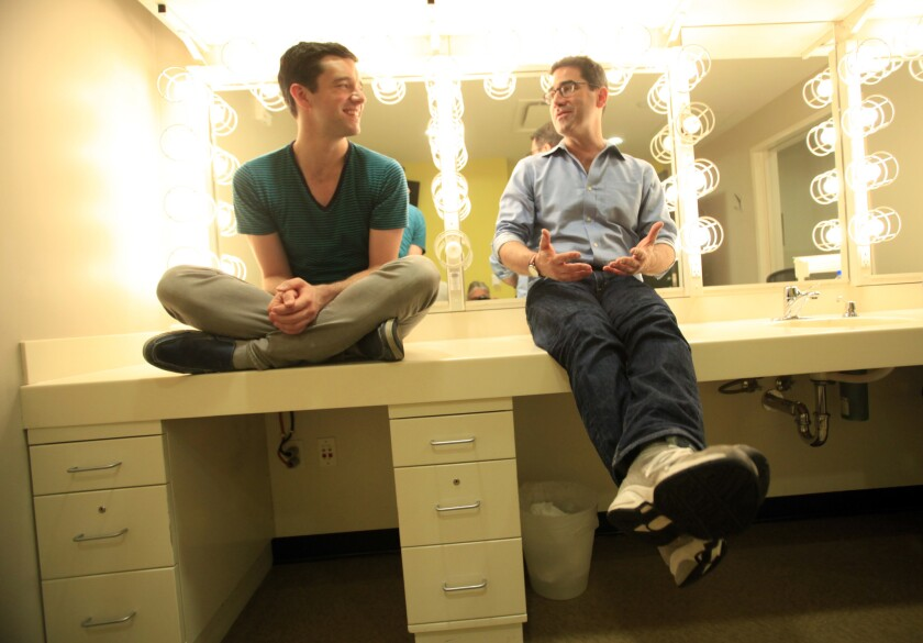 Reunited at the Taper, actor Michael Urie, left, and playwright Jonathan Tolins chat about their off-Broadway hit, now on tour.