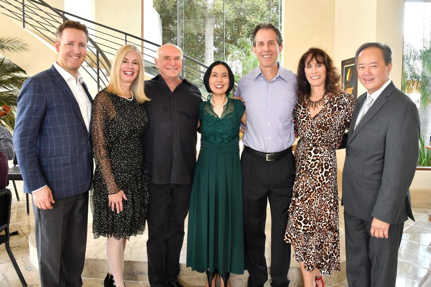 Michael Francis (MM music director), Dr. DeAnn Cary (event hostess), Bill Jech (event host), Jing Bourgeois (event chair) and Jim Freeman, Nancy Laturno (MM executive director), Hernan Constantino (MMYO music director)