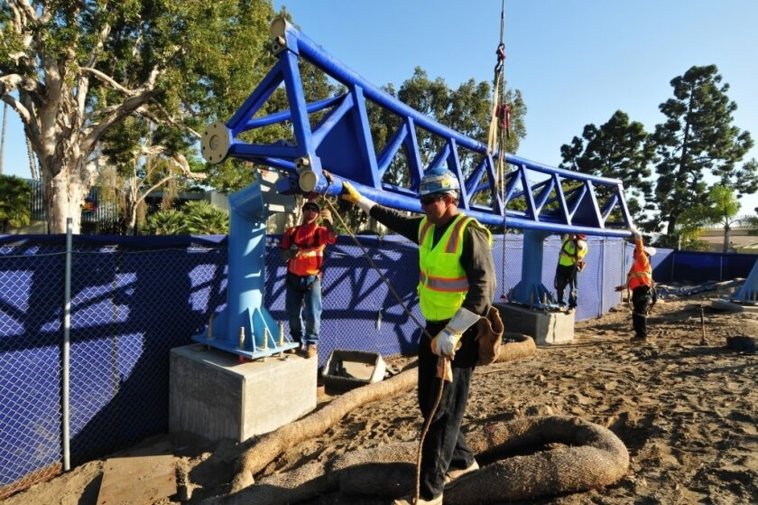 Workers place the first section of track for the new Manta roller coaster ride at SeaWorld that will open next spring.