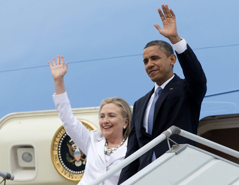 """FILE - In this Nov. 19, 2012 file photo, President Barack Obama and then-Secretary of State Hillary Rodham Clinton wave as they arrive at Yangon International Airport in Yangon, Myanmar on Air Force One. President Barack Obama had some advice for Hillary Rodham Clinton. """"If she's her wonderful self, I'm sure she's going to do great."""" Sounds simple, but friends say Clinton has never shown voters her true self. Mitt Romney couldn't shake the stereotype of callous rich guy. Rand Paul acknowledges he's got to learn how to hold back his temper. Policy is important, but when running for president, figuring out how to fit your personality to politics matters just as much. (AP Photo/Carolyn Kaster, File)"""