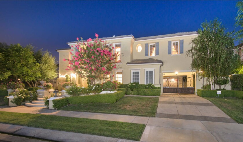 The two-story Calabasas home purchased by Adrienne Bailon boasts five bedrooms, six bathrooms and a handful of formal living spaces in 5,165 square feet.