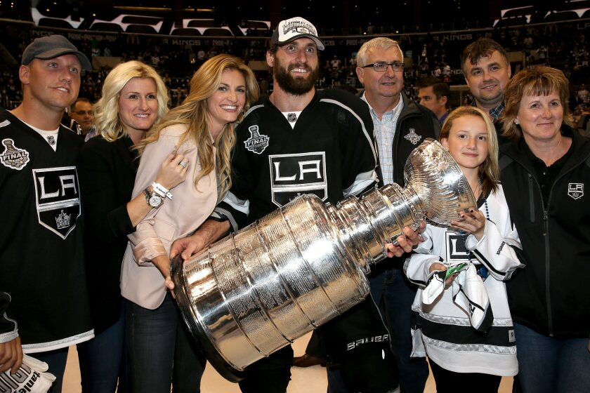 Jarret Stoll celebrates with family and friends, including future wife Erin Andrews, after winning the 2014 Stanley Cup.