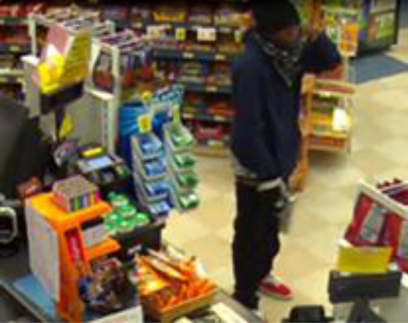 A screen grab from an Arco gas station security camera of an armed robber who killed a man inside the Clairemont store.