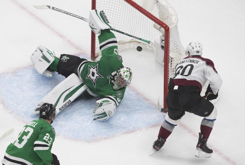 Dallas Stars goalie Anton Khudobin (35) is scored on by Colorado Avalanche's Vladislav Namestnikov (90) during second period NHL qualifying round game action in Edmonton, on Wednesday, Aug. 5, 2020. (Jason Franson/The Canadian Press via AP)