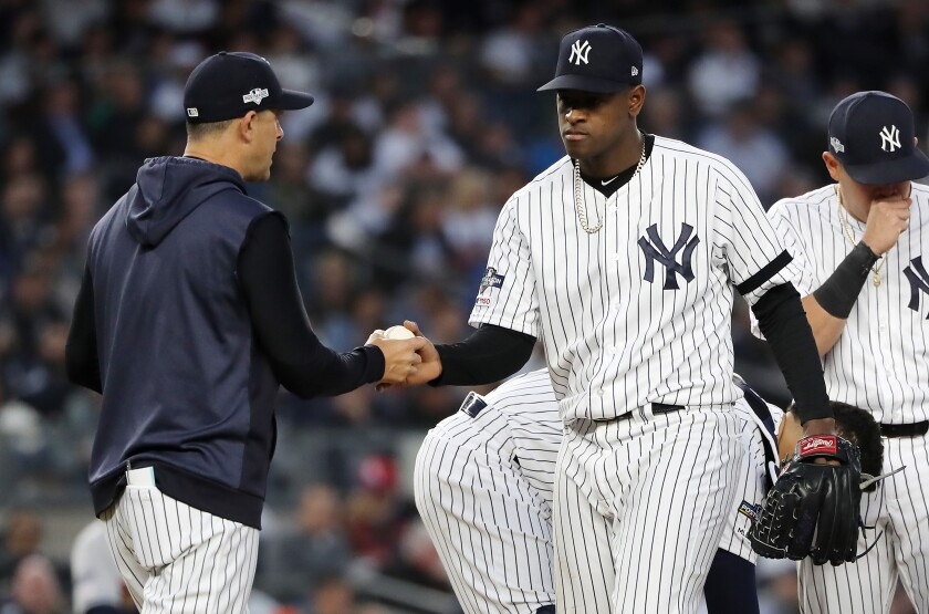 New York Yankees manager Aaron Boone pulls pitcher Luis Severino during the fifth inning against the Houston Astros in Game 3 of the ALCS at Yankee Stadium on Tuesday in New York.