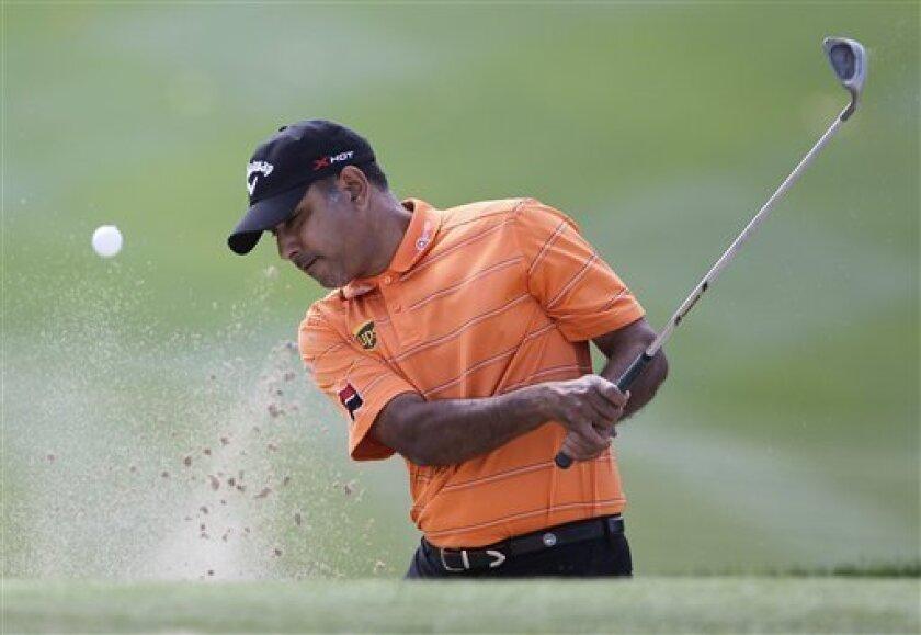 India's Jeev Mikha Singh plays a ball on the 1st hole during final round of the Dubai Desert Classic Golf tournament in Dubai, United Arab Emirates, Sunday, Feb. 3, 2013. (AP Photo/Kamran Jebreili)