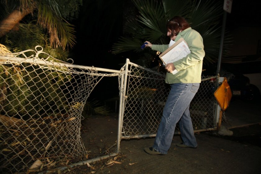 State Assemblymember, 76th District, Toni Atkins uses a flashlight to look for people sleeping in a canyon as she participates in the Point in Time Count in Hillcrest. This year's numbers were up.