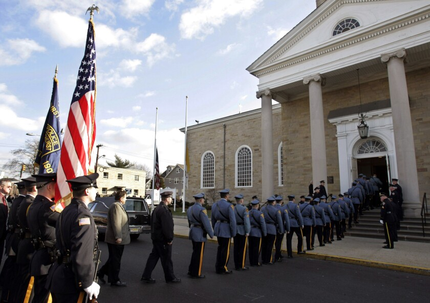 The funeral of New York Police Officer James Zadroga in 2006. The law providing health benefits to first responders was named after Zadroga.