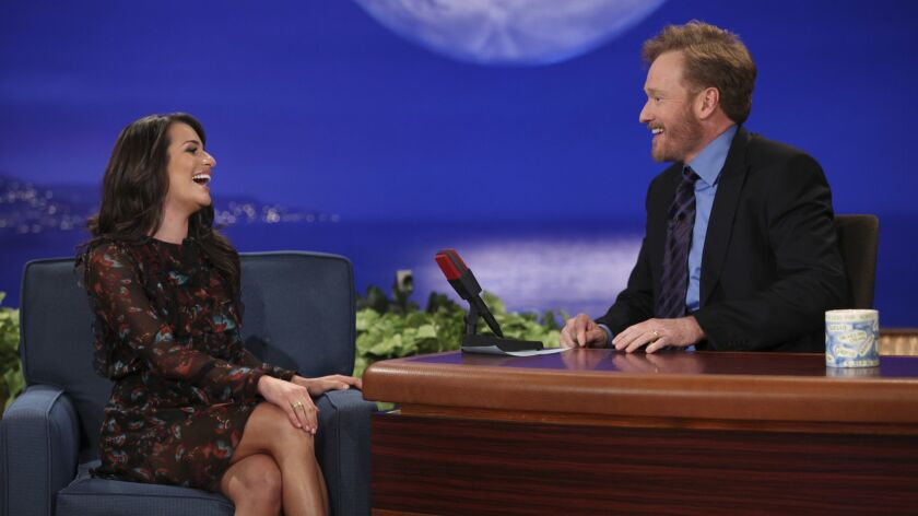 In this photo provided by TBS, Conan O'Brien, right, and guest Lea Michele are seen during the debut