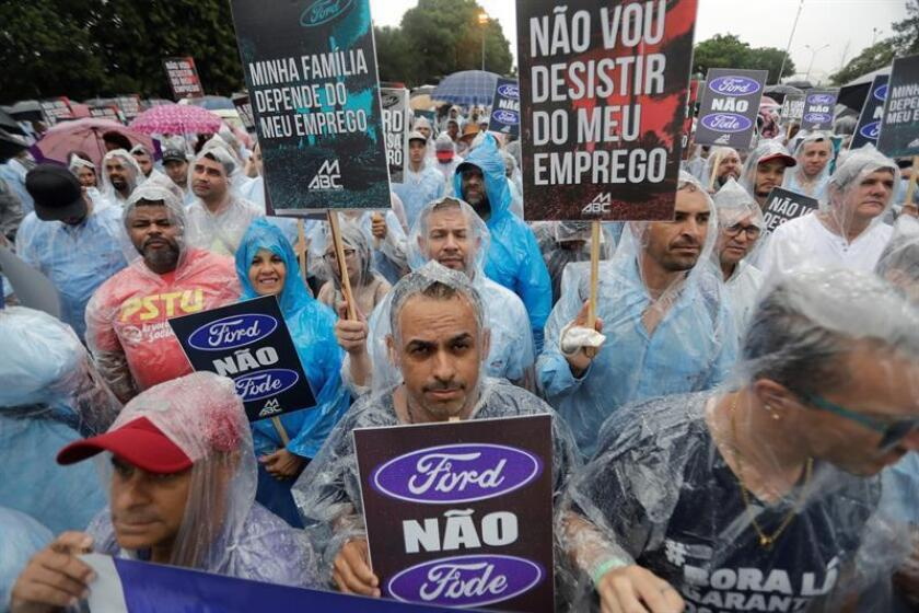 Workers and union members of the metallurgists of the metropolitan region of Sao Paulo protest against the decision of the Brazilian subsidiary of the US Ford to stop production in the Brazilian town of Sao Bernardo do Campo, Brazil, Feb. 26, 2019. The Ford factory - one of the five that make up the industrial belt along with Scania, Volkswagen, Mercedes and Toyota - announced last week that it would close its factory in Sao Bernardo do Campo, one of the seven municipalities in the area, as part of a decision that will leave at least 4,500 people unemployed from November. EPA-EFE/Sebastiao Moreira