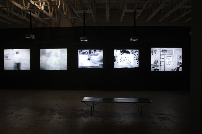 "An installation view of ""Journey to the Moon,"" a series of video works by the South African artist William Kentridge at the Underground Museum."