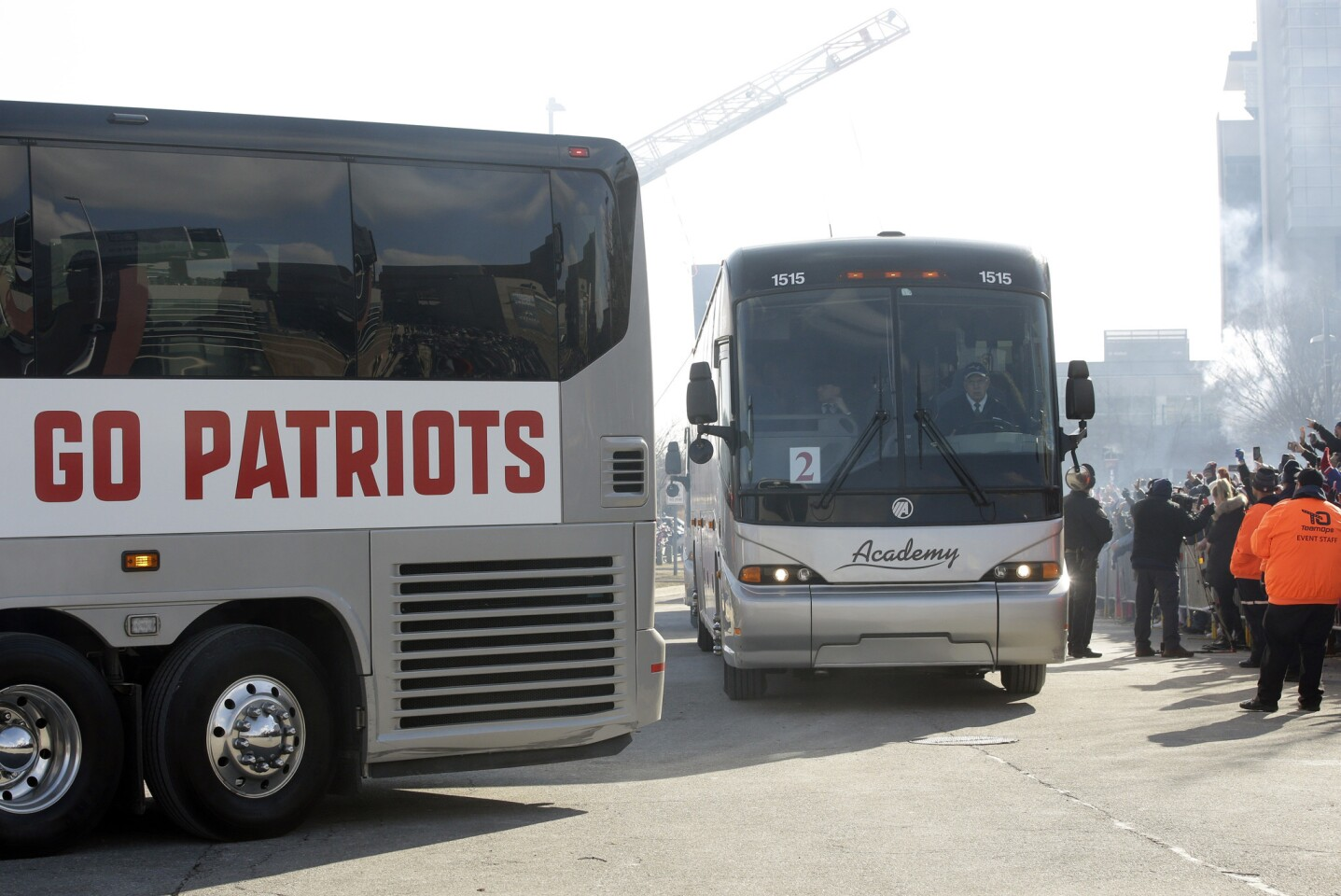 Buses carrying members of the New England Patriots football team depart Gillette Stadium, in Foxborough, Mass., on their way to Atlanta, Ga., following an NFL Super Bowl send-off rally for the team, Sunday, Jan. 27, 2019. The Los Angeles Rams are to play the New England Patriots in Super Bowl 53 on Feb. 3, in Atlanta.