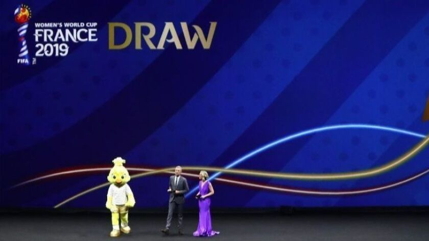 Ettie, the Women's World Cup mascot and host Denis Brogniart and Amanda Davies