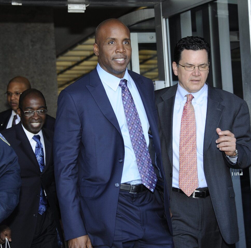 Former major leaguer Barry Bonds leaves the federal courthouse on March 31, 2011, after his perjury and obstruction trial in San Francisco.